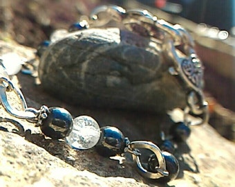 Beautiful bracelet, Hematite and rock crystal, brings courage and protection against negative energies.
