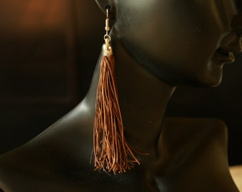 Hand made brown leather tassel earrings Gyppo & Glitterati from France.