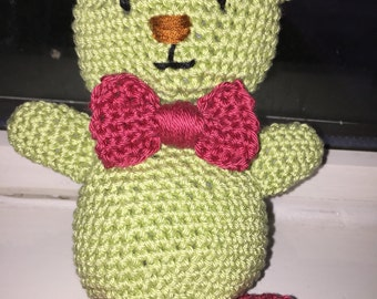 Green teddy bear with red boots