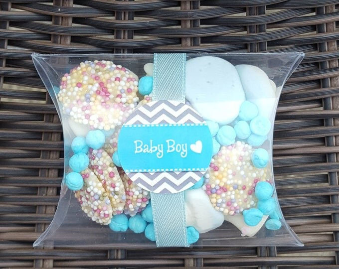Baby shower pillow box favours filled with candy.