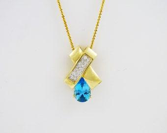3.0 CTW Pear Shape Blue Topaz & .50 CTW Diamond Accent Pendant