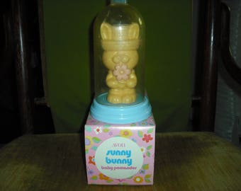 AVON's Sunny Bunny baby pomander is a yellow bunny with a blue dome cover.