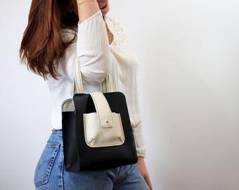 Broken and Black White Leather handbag
