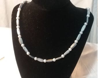 Italian renaissance inspired shell and glass pearl necklace in grey and white.