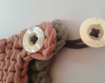 """A """"couple"""" of handmade pot holder with lanyard that buttons to each other and always keeps it together"""