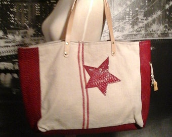 "Red and white cotton canvas tote bag worn hand where shoulder with his ""Duo"" album cover"