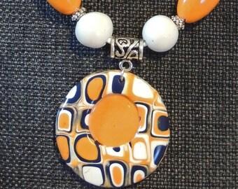 Retro orange, navy and white circular pendant and earring set.