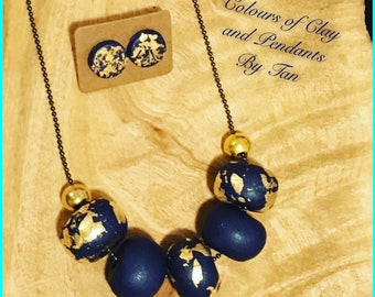 Stunning Clay Necklace with Navy and gold leaf combination