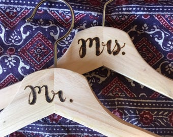 Mrs. and Mr. Wooden clothes hangers