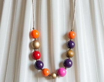 Upcycling chain with 11 colorful balls on satin ribbon
