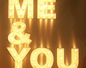 Stylish illuminated sign with atmospheric light bulbs for your wedding decoration, as a wedding gift and your home.