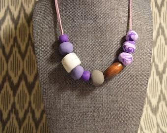 Purple on purple asymmetrical beaded necklace