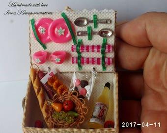 Dollhouse miniature picnic basket.