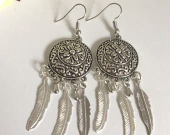 Boho silver tone earrings with feather charms