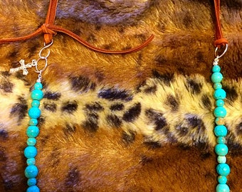 Leather and turquoise beads.