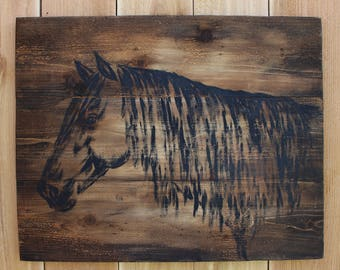 Black horse painted on brown stained wood