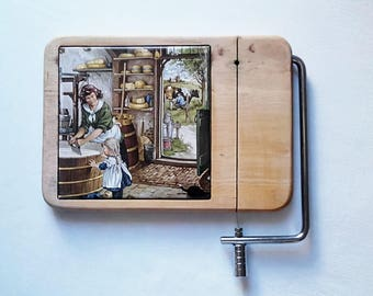 Vintage, wood, ceramic cheese cutting. France 1980