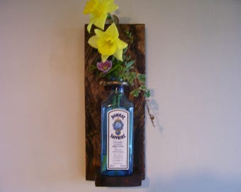 wooden wall sconce with bottle vase