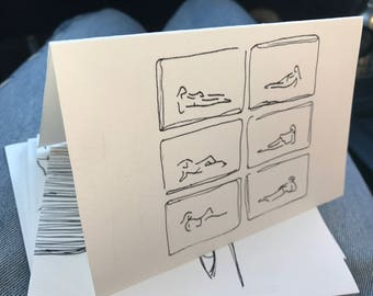 6 figures laying greeting card