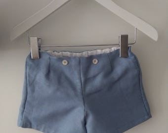 Unisex pants of blue linen with decorative button, white interior lining, handmade baby clothes