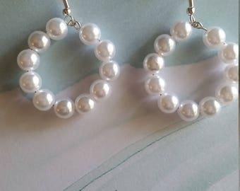 Faux pearl hoop earrings on a French hook