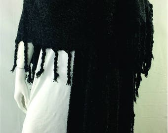 Open wrap with chunky tassels.  Shawl, cape, poncho