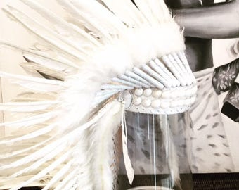 Feathered headdress with shell detail