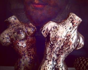 Two hand sculpted miniature bronze torsos.