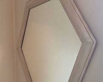 Vintage painted mirror in unusual shape