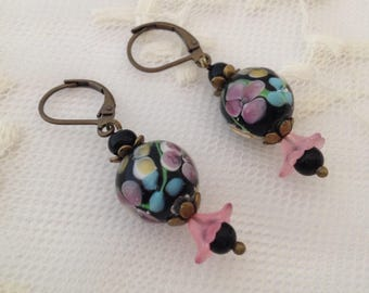 Murano glass and lucite flower clip earrings.