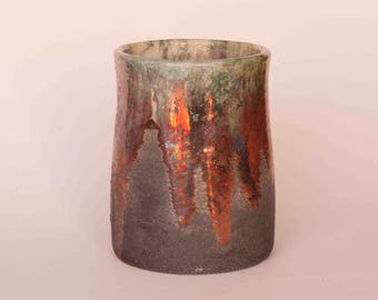 Raku with reflections of copper vase, green and white craquelé