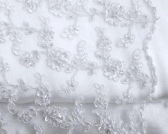 Ivory bridal lace fabric with all-over corded floral design 120cm wide,sold per metre