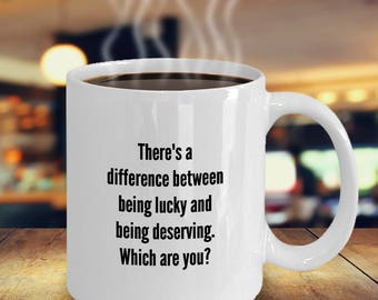 Lucky vs. Deserving Mug