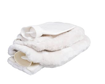 Small hot-water bottle with lambskin cover: natural product. Lambskin sleeve lambskin cover