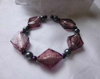 Purple glass beaded stretch bracelet