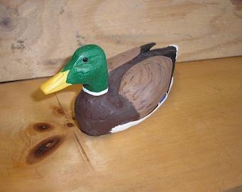 Wood carving of mallard duck