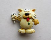 signed vintage JJ Jonette cat pin . funny cat holding mouse and drooling . cute painted enamel cat pin
