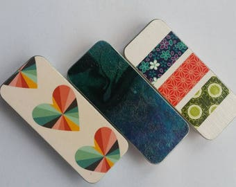Trio of long thin tins. . . Hearts, swirls , and stripes