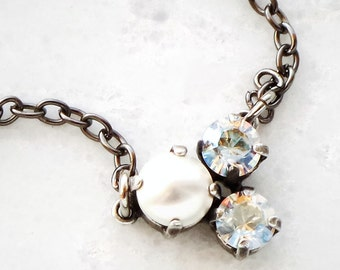 Delicate Swarovski crystal moonlight and white pearl three -stone pendant necklace ,gunmetal plated setting