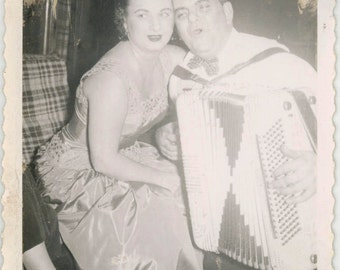 vintage photo 1955 instant film couple He Plays and Sings to Her on Accordion