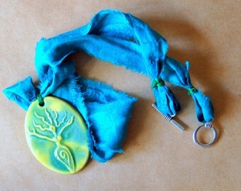 Handmade Ceramic Pendant with a Light Green Vibrant Uprising  Goddess  - Sari Yarn Ribbon - Goddess Jewelry  - Winte Solstice Gift