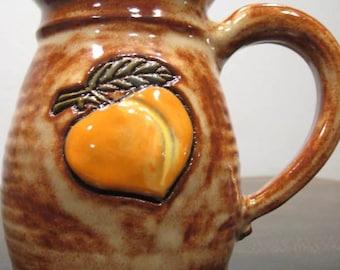 Peachy  Mug  ..............       LEFTY