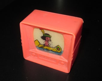 Vintage 70s Pink Plastic Indian in Canoe TV Shaped Pencil Sharpener