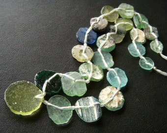 Ancient Roman Glass Coin Shaped Beads - 10 to 22mm - Full Strand - 15 Inches
