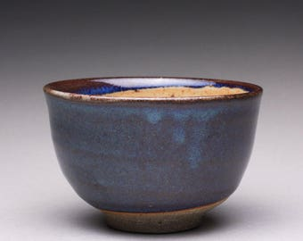 handmade pottery tea bowl, ceramic cup, teacup, small bowl with light orange shino and dark blue glazes