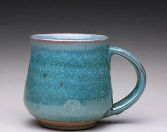 handmade pottery mug, ceramic teacup, coffee cup with turquoise green ash glaze and orange shino