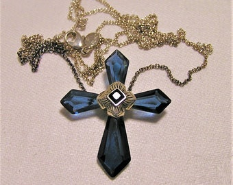 Vintage Deep Blue Crystal Cross Necklace on 24 inch Chain. The Cross has a Black Stone in the Center. It is about 1 1/2 Inches Tall  (D12)