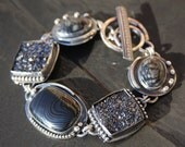 picasso marble, titanium druzy, psilomelane, and sterling silver metalwork link bracelet