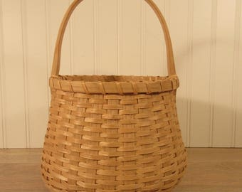 Beautiful hand made split ash basket with wood rim and fixed top wood handle