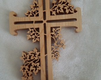 scrolled maple cross with scrolled leaves